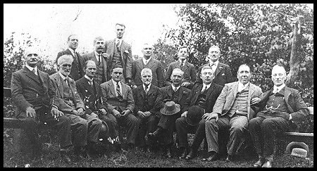 Herbert John, seated front row second from the left, in his later years.  His son Reginald is seated fourth from the left.