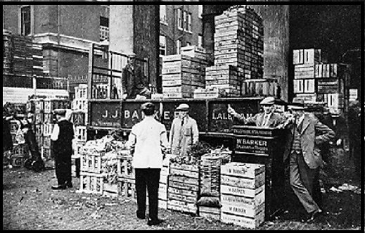 Members of the Barker family, farmers of Laleham on Thames, selling their produce at Covent Garden market.