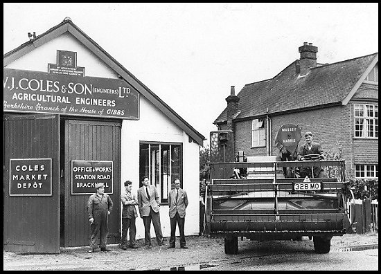 A close-up of Coles premises, with a Massey Harris combine harvester leaving the works.