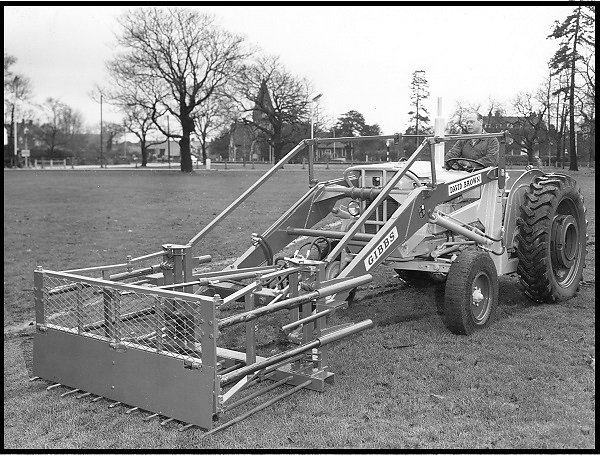 An attachment designed and made by Gibbs for Bushells of Yateley to push mushroom compost onto the heap.